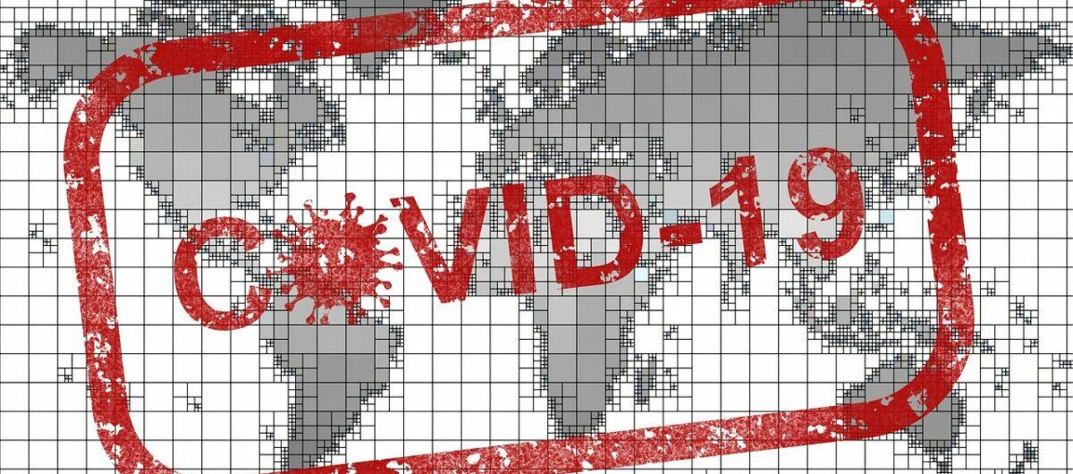 Covid 19 Stempel auf Weltkarte
